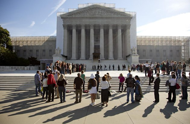 People wait in line to enter the Supreme Court in Washington, Monday, Oct. 1, 2012. The Supreme Court is embarking on a new term that could be as consequential as the last one with the prospect for major rulings about affirmative action, gay marriage and voting rights. (AP Photo/Carolyn Kaster)
