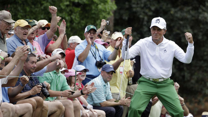 Gary Player reacts after his birdie on the first hole during the par 3 competition at the Masters golf tournament Wednesday, April 4, 2012, in Augusta, Ga. (AP Photo/Matt Slocum)