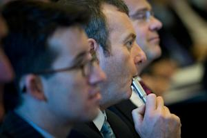 "A delegate uses an e-cigarette during ""The E-Cigarette …"
