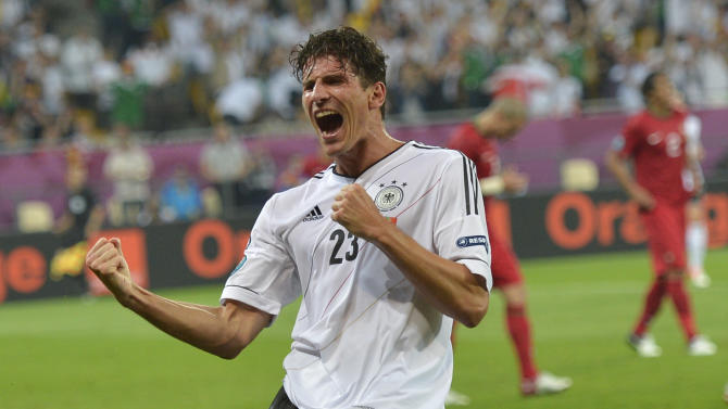 Germany's Mario Gomez celebrates after scoring a goal during the Euro 2012 soccer championship Group B match between Germany and Portugal in Lviv, Ukraine, Saturday, June 9, 2012. (AP Photo/Martin Meissner)