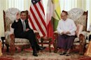U.S. President Obama waves to the press during his meeting with Myanmar&#039;s President Thein Sein in Yangon