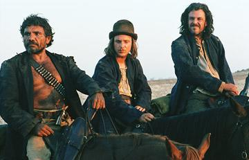 Tom E. Lewis , Tom Budge and Danny Huston in First Look's The Proposition