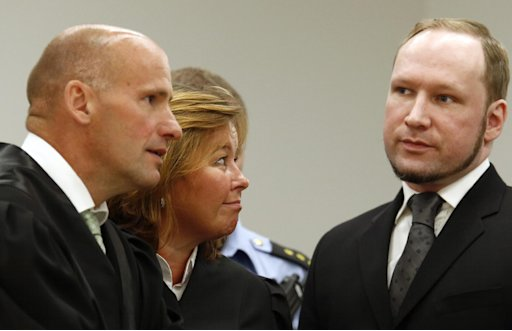 "Defece lawyers  Geir Lippestad, left,  and Vibeke Hein Baera stand together with mass murderer Anders Behring Breivik in the courtroom, Friday, Aug. 24, 2012, in Oslo, Norway. A chapter of a terror case that has haunted Norway for 13 months ended Friday as confessed mass killer Anders Behring Breivik was declared sane and sent to prison for bomb and gun attacks that killed 77 people and injured 200 others last year. After deliberating for two months, a five-judge panel in Oslo's district court handed down a sentence of ""preventive detention"" of at least 10 years and a maximum of 21 years for the right-wing extremist.  (AP Photo/Heiko Junge, NTB Scanpix, Pool)"