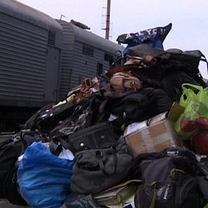 Train carrying MH17 victims leaves crash site