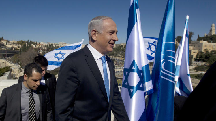 Israeli Prime Minister Benjamin Netanyahu, walks as he arrives to brief the media in Jerusalem, Monday, Jan. 21, 2013.  General elections in Israel will be held Tuesday, Jan. 22, 2013. (AP Photo/Sebastian Scheiner)