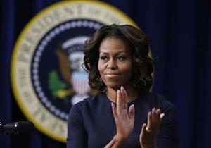 U.S. first lady Obama applauds as she gives remarks at an event on Expanding College Opportunity in Washington