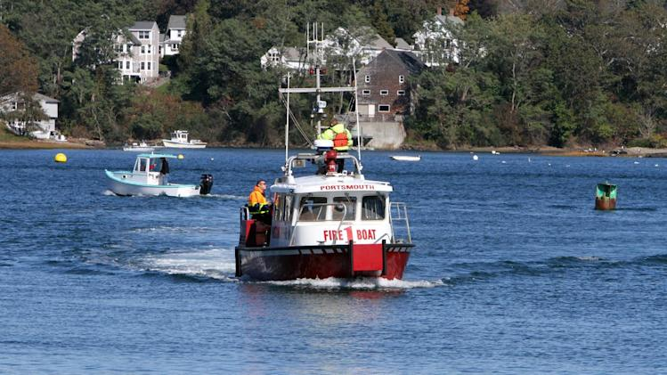 "In this Saturday, Oct. 13, 2012 photo, a Portsmouth fire boat joins the search of the Piscataqua River in Portsmouth, N.H., for the body of missing University of New Hampshire student Elizabeth ""Lizzi"" Marriott of Westborough, Mass. Seth Mazzaglia of Dover, N.H., is accused of strangling or suffocating Marriott on Tuesday, Oct. 9, the day she disappeared. A judge ordered the 29-year-old martial arts instructor held without bail Monday, Oct. 15, on a second-degree murder charge in connection with Marriott's death. Marriott's body hasn't been found and officials are expected to decide Monday how to proceed in the search. (AP Photo/Jim Cole)"