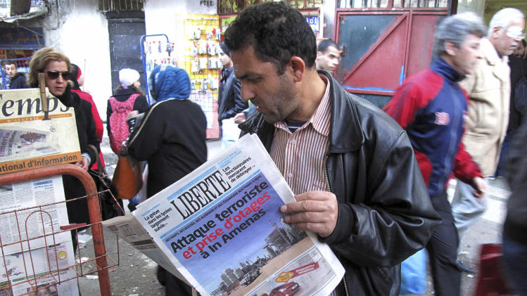 "A man reads a newspaper headlining ""Terrorist attack and kidnapping in In Amenas"", at a news stand in Algiers, Thursday, Jan. 17, 2013. Algerian forces raided a remote Sahara gas plant on Thursday in an attempt to free dozens of foreign hostages held by militants with ties to Mali's rebel Islamists, diplomats and an Algerian security official said. Information on the Algerian assault in the remote area was wildly varying _ Islamic militants claimed that 35 hostages and 15 militants died in a strafing by Algerian helicopters, while Algeria's official news service claimed hundreds of local workers and half the foreigners were rescued. (AP Photo/Ouahab Hebbat)"
