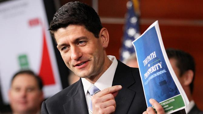 """FILE - In this March 20, 2012 file photo, House Budget Committee Chairman Rep. Paul Ryan, R-Wis., holds up a copy of his budget plan entitled """"The Path to Prosperity,"""" during a news conference on Capitol Hill in Washington. There are plenty of reasons for Republican presidential candidate Mitt Romney to choose Wisconsin Rep. Paul Ryan as a running mate. The whip-smart congressman is from a battleground state. He's the GOP's leading voice on the nation's budget and is the rare member of the Republican establishment who's loved by the tea party.  (AP Photo/Jacquelyn Martin, File)"""