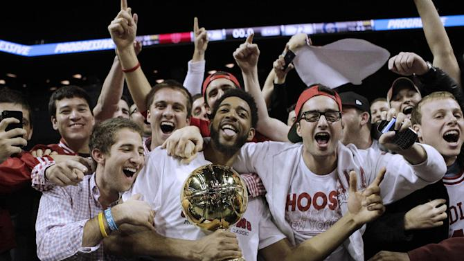 Indiana forward Christian Watford (2) holds the trophy while celebrating with fans after defeating Georgetown in the championship game in Round 2 of the Legends Classic NCAA college basketball tournament at the Barclays Center, early Wednesday, Nov. 21, 2012, in New York. (AP Photo/Kathy Willens)