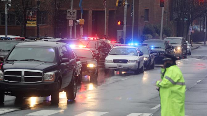 Police cars fill the street outside the New Castle County Courthouse, Monday morning, Feb. 11, 2013 in WiIlmington, Del. , after a man killed his estranged wife and two others at the courthouse.  The mayor of Wilmington says police have killed the gunman.  (AP Photo/The News Journal/William Bretzger)  PHILADELPHIA TV OUT AND PHILADELPHIA ONLINE SITES OUT