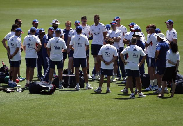 England's cricket team coach Flower talks with members of the team during a training session in Brisbane