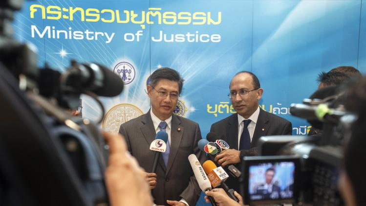 Thailand's Acting Permanent Secretary for Justice Chanchao Chaiyanukit and Australian Foreign Ministry Permanent Secretary Peter Varghese answer questions in Bangkok