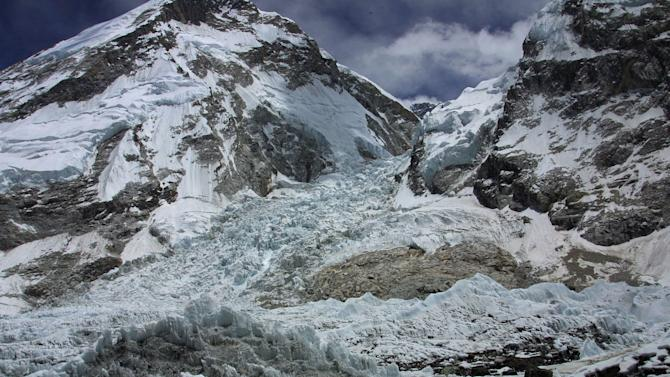 FILE - In this Saturday May 17, 2003 file photo, a view of the Kumbhu icefall, the first hurdle in the ascent to Everest from base camp, is seen from Everest Base camp, where 12 Nepalese guides were killed, Nepal. An avalanche swept down a climbing route on Mount Everest early Friday, killing at least 12 Nepalese guides and leaving three missing in the deadliest disaster on the world's highest peak. (AP Photo/Gurinder Osan, file)