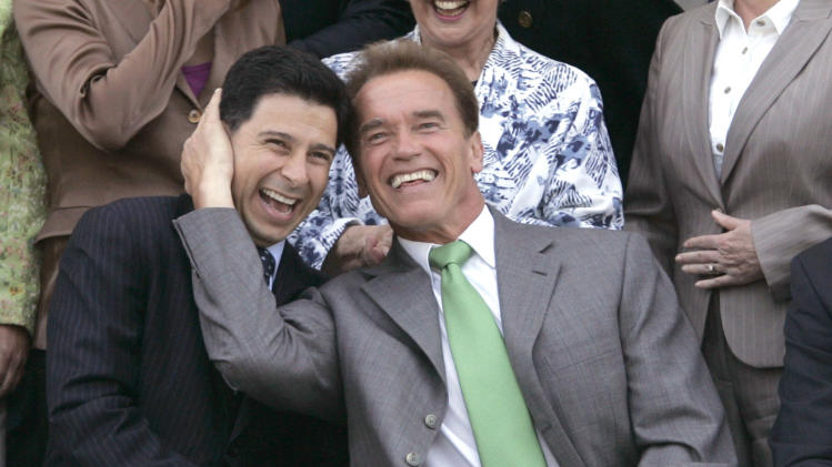 FILE - In this June 13, 2007, file photo, former Gov. Arnold Schwarzenegger, right, and former Assembly Speaker Fabian Nunez, D-Los Angeles, joke around before a legislative group photo is taken at the Capitol in Sacramento, Calif. In one of his last formal acts as governor, Schwarzenegger used his executive powers to grant clemency to Nunez' son,  who was involved in a fatal stabbing and pleaded guilty to manslaughter charges. (AP Photo/Rich Pedroncelli, file)