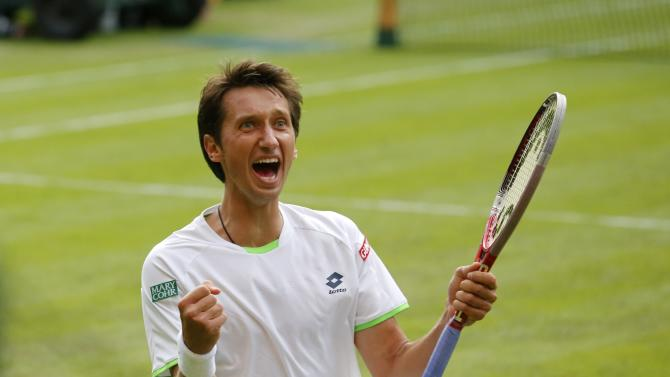 Sergiy Stakhovsky of Ukraine reacts as he wins against Roger Federer of Switzerland in their Men's second round singles match at the All England Lawn Tennis Championships in Wimbledon, London, Wednesday, June 26, 2013. (AP Photo/Anja Niedringhaus)