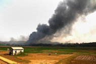 Smoke billows following an explosion at a firework factory in the northern Vietnamese province of Phu Tho, on October 12, 2013