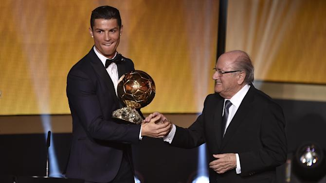 Cristiano Ronaldo (left) shakes hands with Sepp Blatter after receiving the 2014 FIFA Ballon d'Or award in Zurich on January 12, 2015
