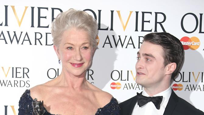 Helen Mirren winner of Best Actress Award for The Audience and Daniel Radcliffe  in the press room at the Olivier Awards 2013 at the Royal opera House in London on Sunday, April 28th, 2013. (Photo by Joel Ryan/Invision/AP)