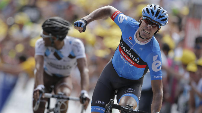 David Miller of Britain crosses the finish line ahead of Jean-Christophe Peraud of France, left, to win the 12th stage of the Tour de France cycling race over 226 kilometers (140.5 miles) with start in Saint-Jean-de-Maurienne and finish in Annonay, France, Friday July 13, 2012. (AP Photo/Christophe Ena)