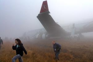 Passengers walk away from a Turkish Airlines plane …