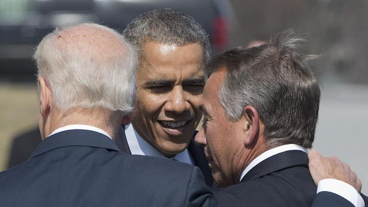 Vice President Joe Biden, left, puts his arm around House Speaker John Boehner of Ohio as they speak with President Barack Obama as they leave Friends of Ireland luncheon on Capitol Hill in Washington, Friday, March 14, 2014. (AP Photo/Pablo Martinez Monsivais)