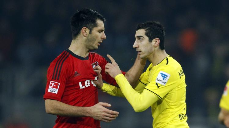 Bayer Leverkusen Emir Spahic has a confrontation with Borussia Dortmund's Henrikh Mkhitaryan during their German first division Bundesliga soccer match in Dortmund