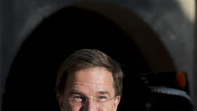 FILE - In this Oct. 27, 2014 file photo Dutch Prime Minister Mark Rutte steps outside to welcome Belgium's Prime Minister Charles Michel in The Hague, Netherlands. The future of Mark Rutte's two-party coalition hangs in the balance Thursday, Dec. 18, 2014, amid behind-closed-doors discussions aimed at rescuing health care reforms intended to shave 1 billion euros ($1.25 billion) off government spending. The package was rejected Tuesday thanks in part to the votes of three government senators. (AP Photo/Peter Dejong, File)