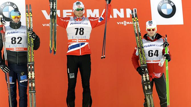 Norway's Petter Northug Jr. centre, celebrates on the podium after winning the men's 15 km cross country skiing World Cup event at the Lahti Ski Games in Lahti, Finland on Sunday, March 10, 2013. Kazakhstan's Alexey Poltoranin ,left, came second, with Norwegian Martin Johnsrud Sundby placed third. (AP Photo/Lehtikuva, Markku Ulander) FINLAND OUT. NO SALES.