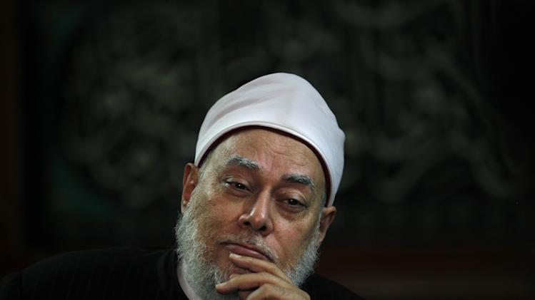 FILE - In this Thursday, Sept, 27, 2012 file photo, Egypt's Grand Mufti Ali Gomaa speaks during an an interview with The Associated Press at his office in Cairo, Egypt. Gomaa, also known at the green mufti, has been outspoken on pollution and climate change, calling them greater threats than war, according to the consultancy Green Compass Research. (AP Photo/Nasser Nasser, File)