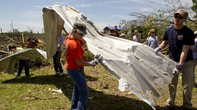 A group of Auburn students assist in the clean up of debris on Thursday, May 5, 2011 in Pleasant Grove, Ala. A tornado left a path of total devastation as it passed through on April 27, 2011.(AP Photo/Butch Dill)