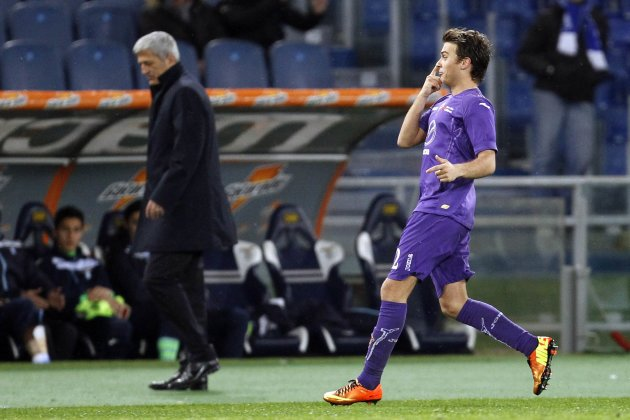Fiorentina's Ljajic celebrates after scoring next to SS Lazio's coach Vladimir Petkovic during their Italian Serie A soccer match in Rome