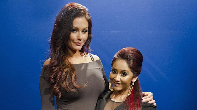 "FILE - This Feb. 1, 2012 file photo shows Jenni ""JWoww"" Farley, left, and Nicole ""Snooki"" Polizzi in New York. The Point Pleasant Beach Council in New Jersey unanimously voted against 495 Productions' request to tape the ""Jersey Shore"" spinoff featuring Polizzi and Farley. Nearby Toms River also turned down the MTV reality series. ""Snooki & JWoww"" taped its first season in Jersey City. (AP Photo/Charles Sykes, file)"