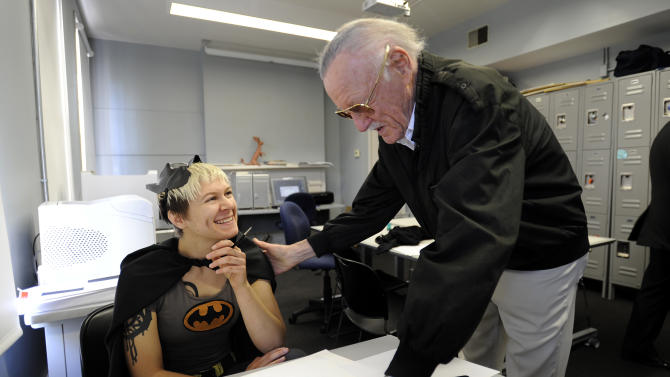 Legendary comic creator Stan Lee, right, looks over a drawing by Savannah College of Art and Design sequential art student Jen Hickman while visiting the college in Savannah, Ga.,  on Wednesday, Oct. 31, 2012.  Lee, the 89-year-old co-creator of Spider-Man, dropped in on the school after being honored at the SCAD Savannah Film Festival. (AP Photo/Stephen Morton)