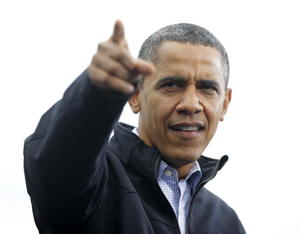 President Barack Obama points to supporters during a campaign event at Sloan's Lake Park, Thursday, Oct. 4, 2012, in Denver. (AP Photo/Pablo Martinez Monsivais)