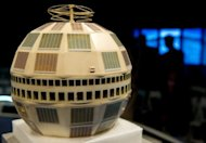 A model of the Telstar satellite is seen on stage beofre the start of an event to mark the 50th anniversary of the first live television broadcast between continents