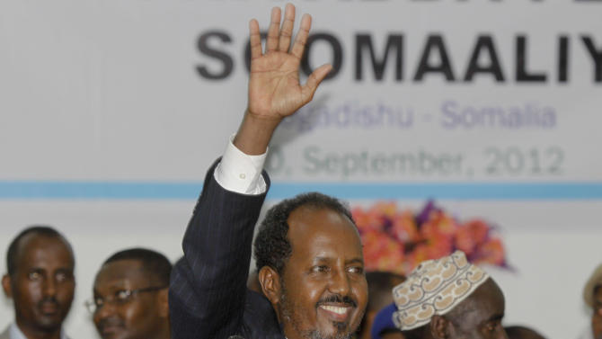 Somalia's new president Hassan Sheikh Mohamud, a political newcomer, speaks at a ceremony after being elected by the Parliament over outgoing President Sheik Sharif Sheikh Ahmed who conceded defeat, in Mogadishu, Somalia Monday, Sept. 10, 2012. Somalia's Parliament elected a new president of the country's fledgling government Monday, a move that members of the international community say is a key step toward the east African nation's transition from a war-torn failed state to a nation with an effective government. (AP Photo/Farah Abdi Warsameh)