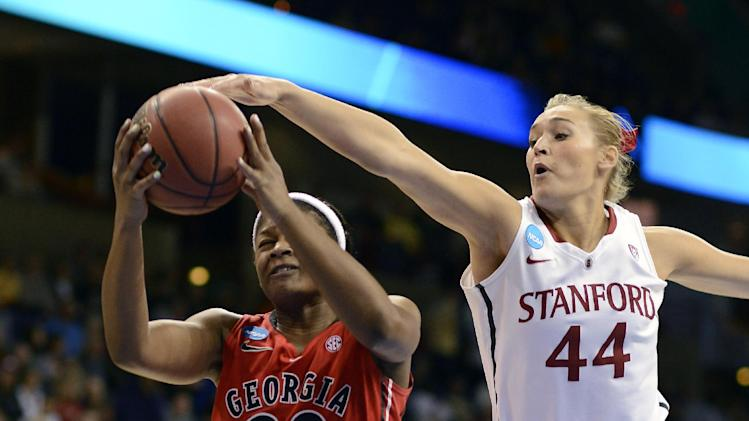 Georgia's Shacobia Barbee (20) makes a drive as Stanford's Joslyn Tinkle (40) gets a hand on the ball in the first half of a regional semifinal in the NCAA women's college basketball tournament, Saturday, March 30, 2013, in Spokane, Wash. (AP Photo/Jed Conklin)