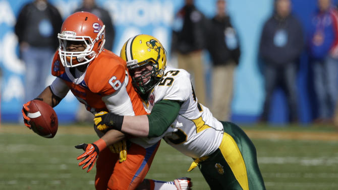 Sam Houston State wide receiver Richard Sincere (6) is sacked by North Dakota State's Kyle Emanuel (53) after taking the snap at the line of scrimmage during the first half of the FCS Championship NCAA college football game Saturday, Jan. 5, 2013, in Frisco, Texas. (AP Photo/Tony Gutierrez)