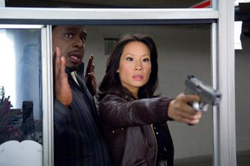Cedric the Entertainer and Lucy Liu in New Line Cinema's Code Name: The Cleaner