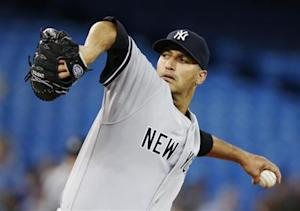 Yankees Pettitte pitches to the Blue Jays during their MLB baseball game in Toronto