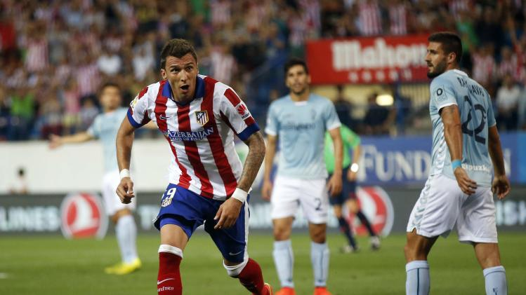 Atletico Madrid's Mario Mandzukic celebrates his goal against Eibar during their Spanish first division soccer match at Vicente Calderon stadium in Madrid