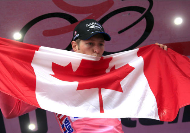 Canadian Garmin Team Cyclist Ryder Hesjedal Kisses AFP/Getty Images
