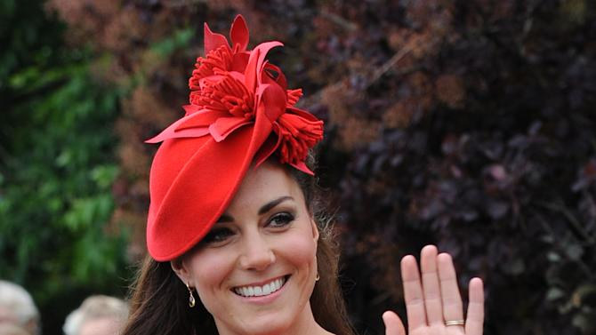 Britain's Kate, Duchess of Cambridge prepares to board the royal barge as she and Prince William joined the Queen for the Diamond Jubilee Pageant on the River Thames in London  Sunday June 3, 2012.  More than 1,000 boats will sail down the River Thames on Sunday in a flotilla tribute to Queen Elizabeth II's 60 years on the throne that organizers are calling the biggest pageant on the river for 350 years. (AP Photo/Stefan Rousseau/Pool)