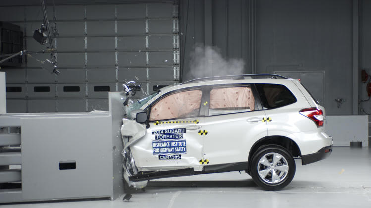 "This undated image provided by the Insurance Institute for Highway Safety shows a 2014 Subaru Forester during a small overlap frontal crash test. Subaru's 2014 Forester is one of only two of 13 small SUVs that are getting passing grades in front-end crash tests done by the Insurance Institute for Highway Safety. Popular models such as the Honda CR-V, Ford Escape and Jeep Wrangler received only ""marginal"" or ""poor"" ratings from the Insurance Institute for Highway Safety. (AP Photo/he Insurance Institute for Highway Safety)"
