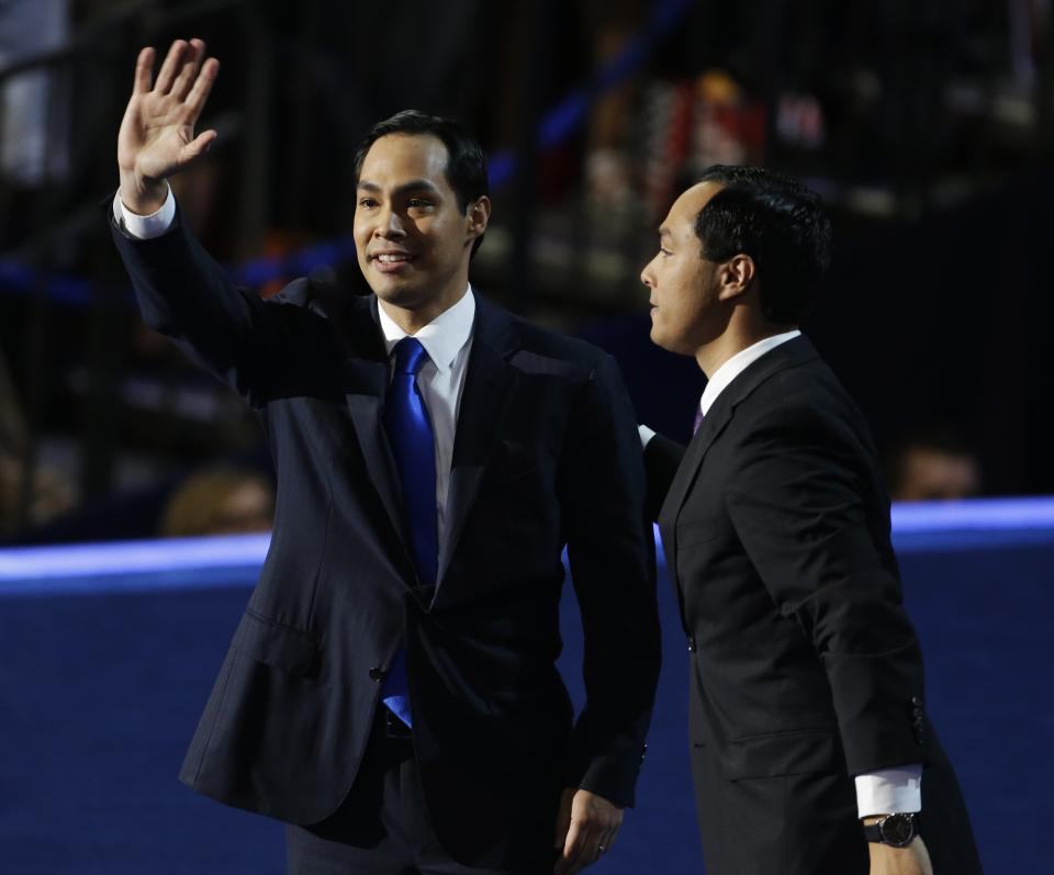 San Antonio Mayor Julian Castro, left, and his brother Joaquin Castro, wave at delegates at the Democratic National Convention in Charlotte, N.C., on Tuesday, Sept. 4, 2012. (AP Photo/Lynne Sladky)