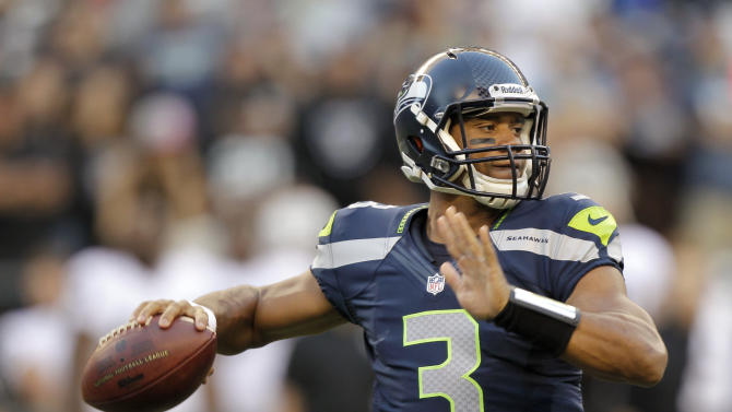 FILE - This Aug. 30, 2012 file photo shows Seattle Seahawks rookie quarterback Russell Wilson dropping back to pass against the Oakland Raiders in the first half of a preseason NFL football game in Seattle. Youth and inexperience have taken over the most important position in the NFL. Ten starting quarterbacks will have one year or less of experience this season, with five teams letting rookies run the show. (AP Photo/Stephen Brashear, File)