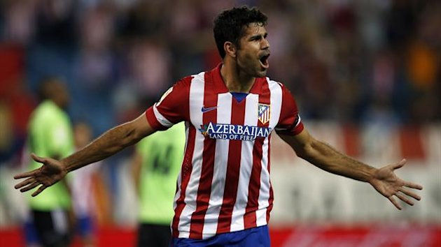 Atletico Madrid's Diego Costa celebrates after scoring his second goal against Osasuna during their Spanish first division soccer match at Vicente Calderon stadium in Madrid September 24, 2013 (Reuters)