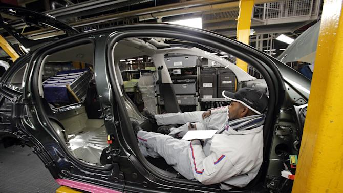 A worker takes a break in a car the French car manufacturer PSA Peugeot Citroen assembly line, in Aulnay-sous-Bois, north of Paris, Monday, Jan. 28, 2013 as some unions decided for a new strike. The Aulnay plant has been at the center of a battle over the future of France's largest automaker. The company announced last year that it planned to cut 8,000 jobs and close Aulnay as it struggles to compete in Europe's stagnant car market. (AP Photo/Christophe Ena)
