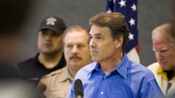 Texas Gov. Rick Perry, who cut short a presidential campaign trip to South Carolina to return to help oversee firefighting efforts in Texas, speaks during a news conference Tuesday, Sept. 6, 2011, in Austin, Texas. Perry marveled at the destruction and pointed out that more than 100,000 acres in the drought-stricken state had burned over the past week, and that more than 3.5 million acres _ an area roughly the size of Connecticut _ had burned since December. (AP Photo/Austin American-Statesman, Ricardo B. Brazziell)  MAGS OUT; NO SALES; TV OUT;  AP MEMBERS ONLY